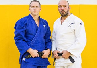 Sam Ingram, GB Paralympic judoka (right) with coach Euan Burton