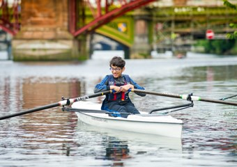 Young people learn to row
