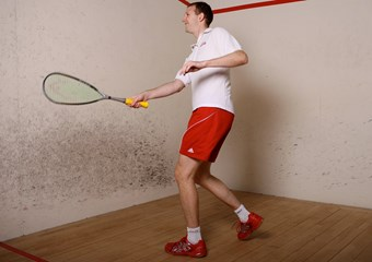 Jonathan MacBride playing squash