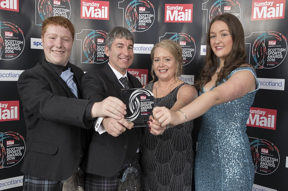 Logan Darling, Ian Brownlie ,Heather Brownlie and Emma Waldie pick of the Local Club of the Year award for the City of Edinburgh Volleyball Club