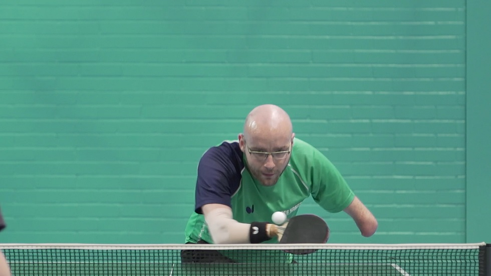 Martin Perry playing table tennis