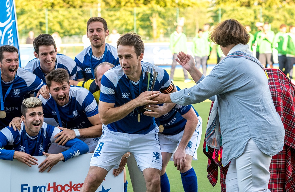 Chris Grassick lifts the EuroHockey Championship II trophy