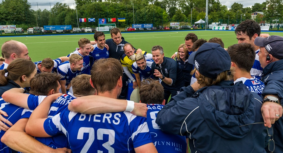 Scotland head coach Derek Forsyth leads the celebrations