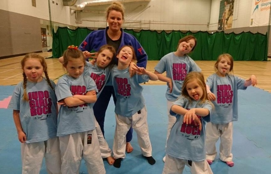 Rebecca Maclean with one of her classes at Judo Girls Rock