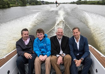 Alan Murray and others in a boat