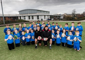 Tom Brown and Ross Ford with children from Broomhouse Primary School