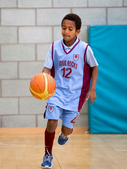A youngster enjoys basketball