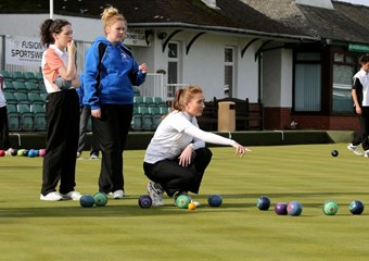 Young female bowlers in action at Priorscroft Bowls Club in Paisley