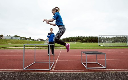 Physical preparation coach Euan Macleod oversees an athletics session in the Western Isles