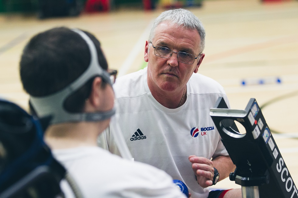 Gary McCowan working as boccia ramp assistant to his son Scott at sportscotland Inverclyde