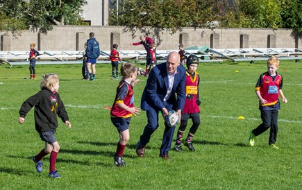 Joe FitzPatrick plays rugby with children in Dundee