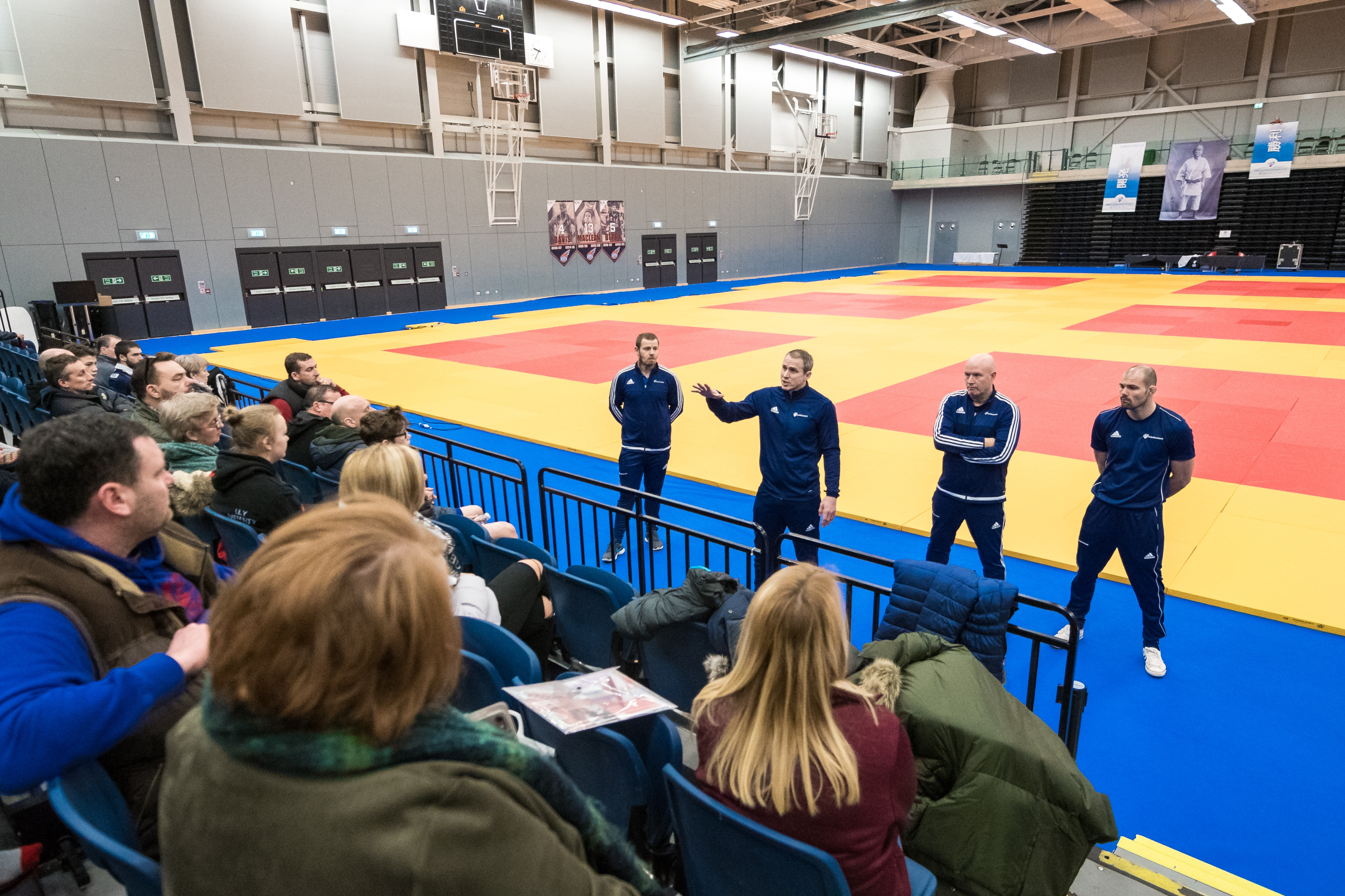 Euan Burton talks to judo parents at the Emirates Arena