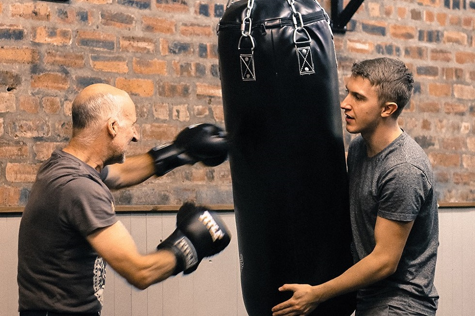 David Gray hits the bag with coach Calum Harper