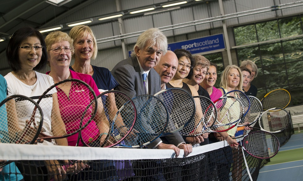 Sports Minister Joe FitzPatrick and sportscotland chair Mel Young with female tennis players