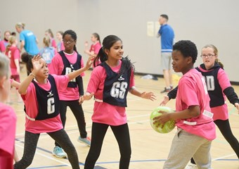 Young people participating in netball