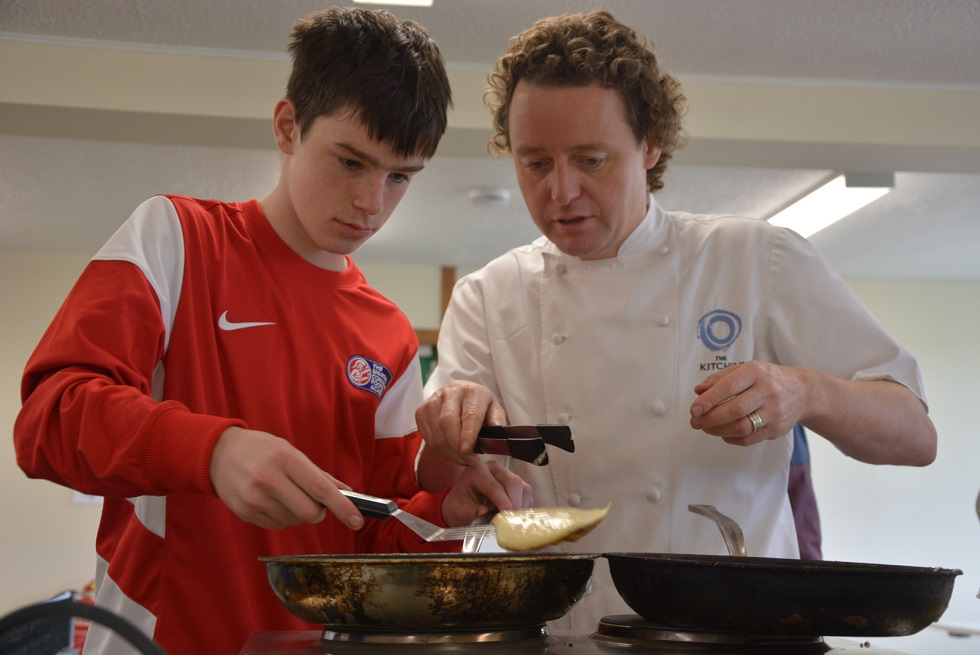 Tom Kitchin with a member of The Spartans Community Football Academy
