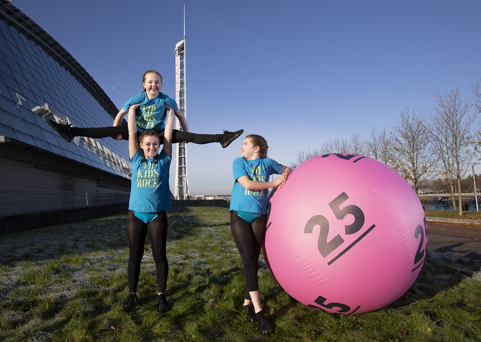 Posing alongside a giant pink number 25 National Lottery ball gymnasts Krystel Trainer, Madeline Kerr and Taylor McAllister from VIP Sports Academy in Motherwell