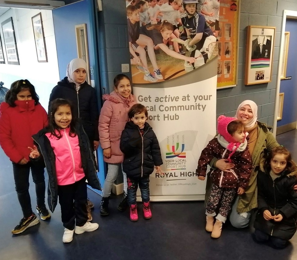 Syrian refugee families visit a swimming pool in Edinburgh