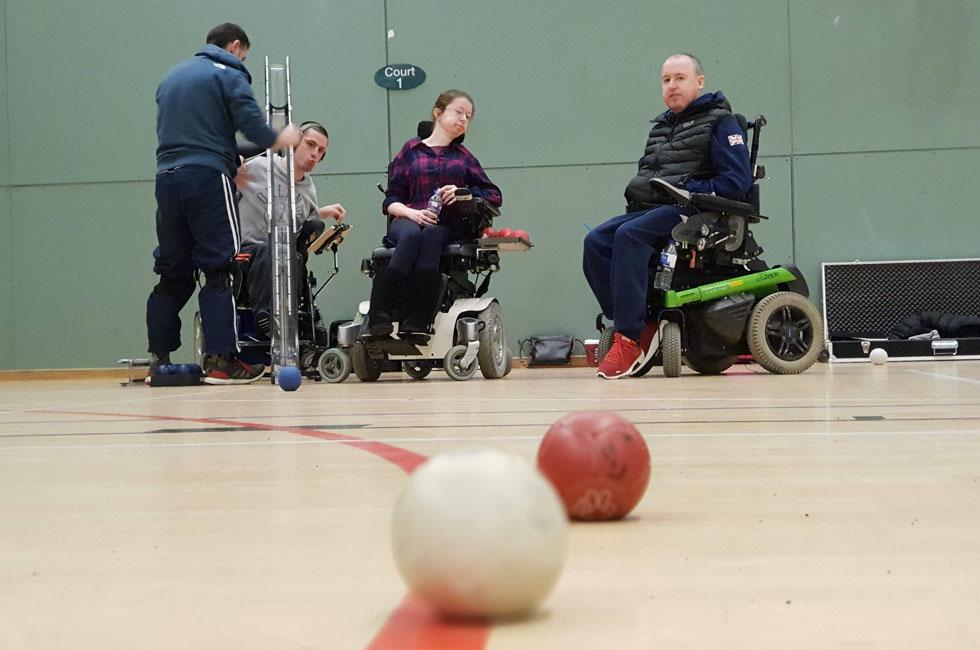 Wheelchair users playing boccia