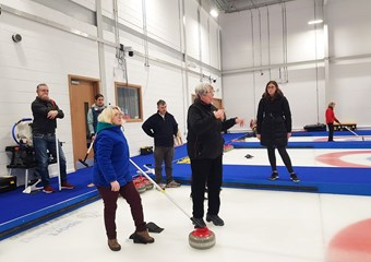 Sandra Black participates in a deaf-friendly curling session at the National Curling Academy