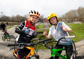 Youth cyclists at a BMX facility