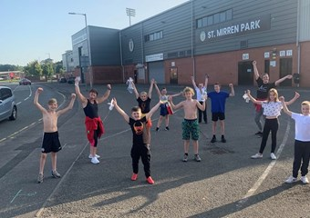 Karen Campbell with a youth group taking part in an exercise session outside St Mirren Park in Paisley
