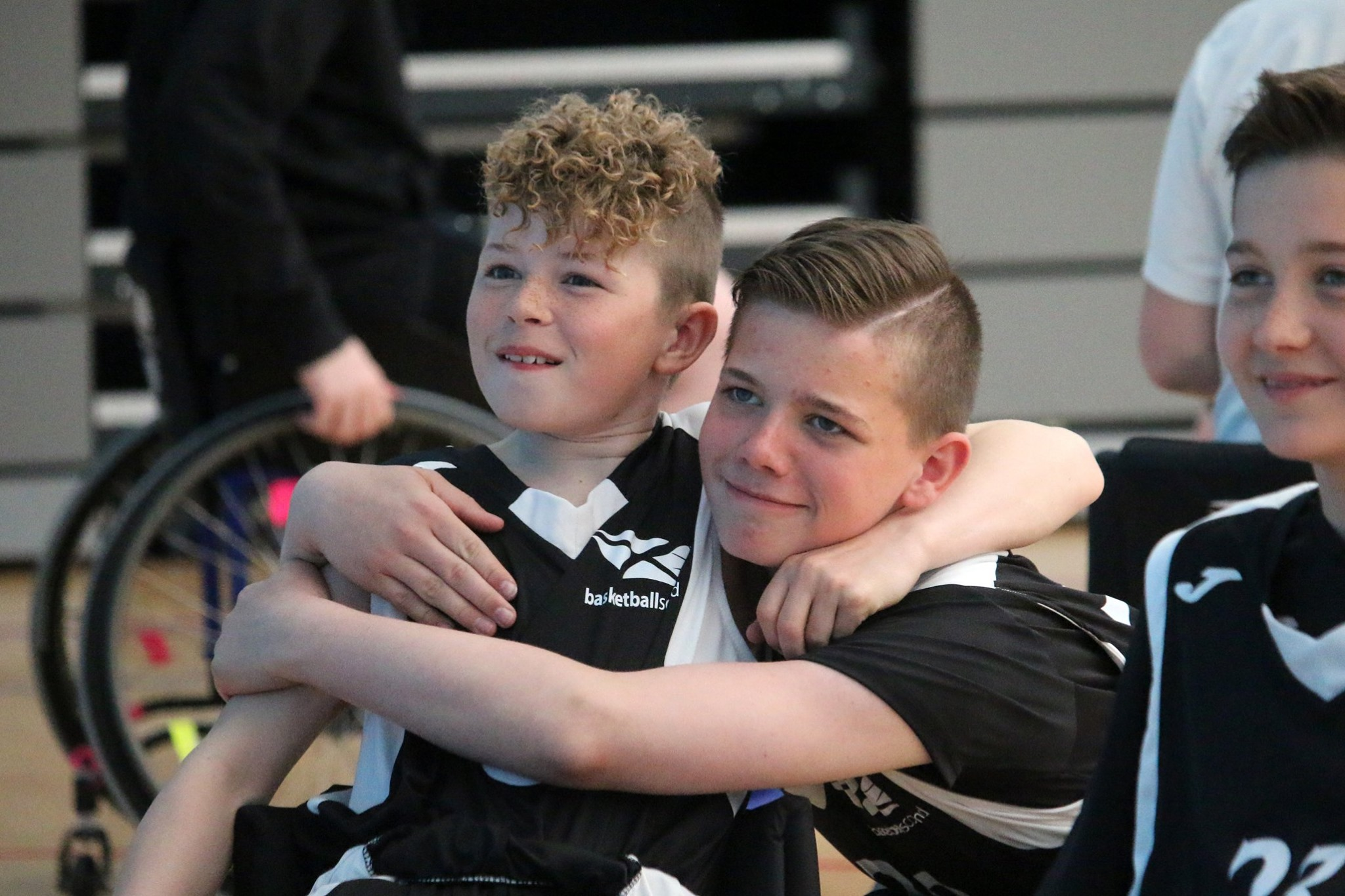 Wheelchair basketball participants celebrate win